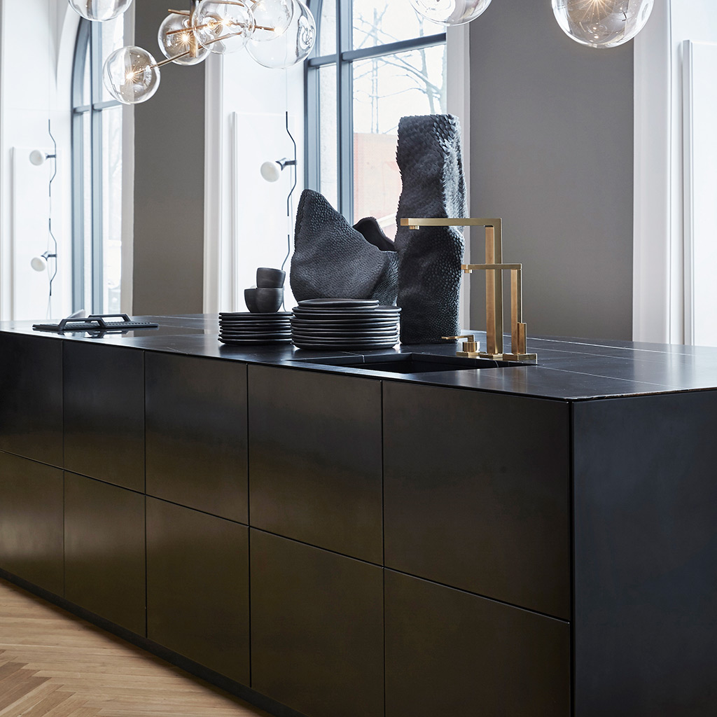 A unique and bespoke kitchen island in blackened steel